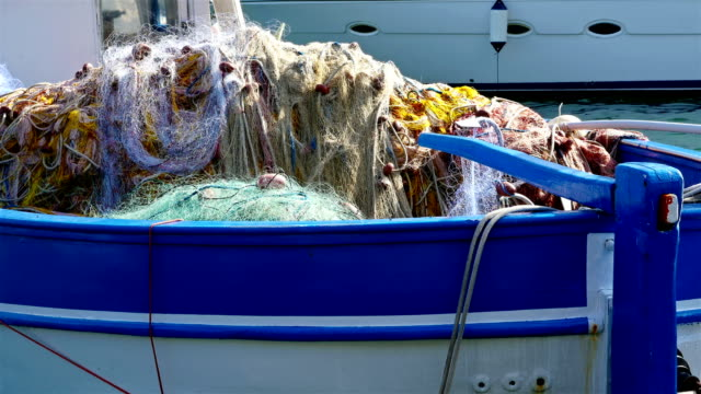 Detail view of a swaying fishing boat with fishnets in gulf of Naples, Italy video