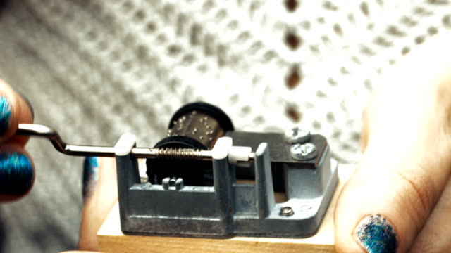 Detailed view of the insides of an old vintage music box as it plays. Slow tracking movements video