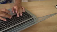 Details female fingers typing on the laptop video