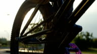 EXTREME CLOSE UP: Details of a bmx bike equipment, sun shining through a wheel video