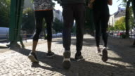 Determined friends jogging under bridge video