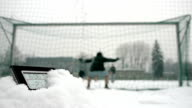 determined soccer players winter time thermometer in foreground video