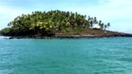 Devil's Island seen from the ship. Ruins of penal colony on the coast video