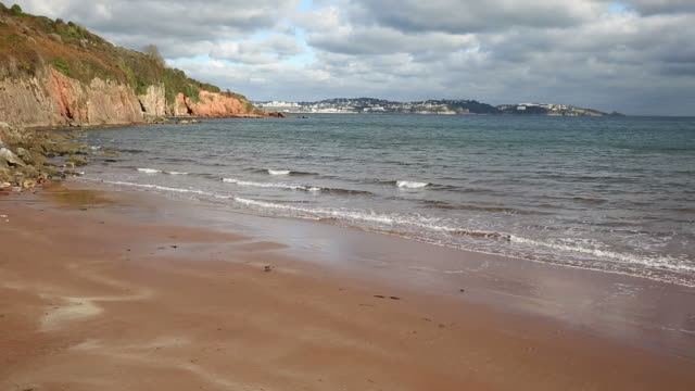 Devon beach sea and coast towards Torquay England UK from Salturn Cove video