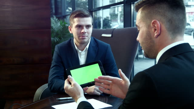 Dialogue of businessmen using the touchpad video