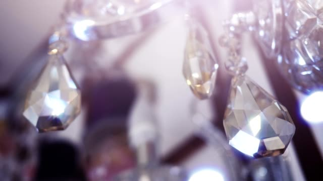 Diamond shape crystals on a beautiful chandelier. video
