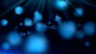 Blue rays with flowing colorful particles in 3D space video