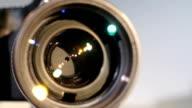 Diaphragm of a camera lens aperture, close up, open, glare video