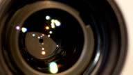Diaphragm of a camera lens aperture, close up, open, macro video