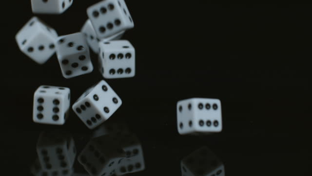 Dice dropping and bouncing in slow motion video