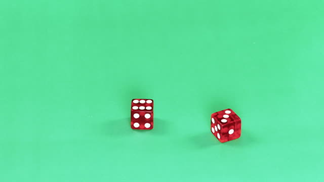 Dice on green background video