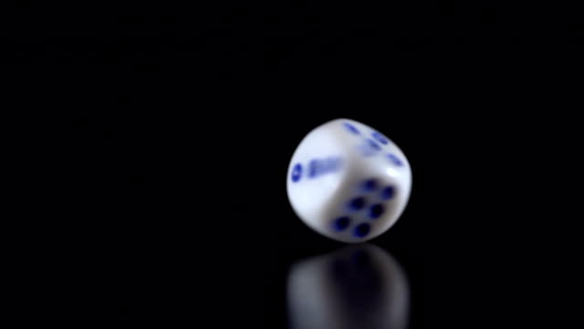 Dice throw on a black table video