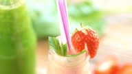 Different fresh smoothies on the wooden table video