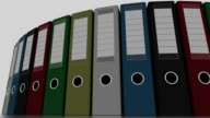 Different office binders rotate, low angle wide shot. FullHD seamless loopable animation video