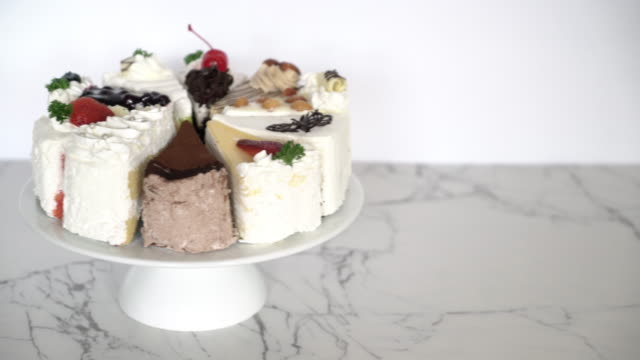 different pieces of cake on stand video