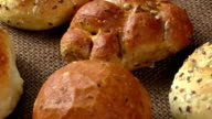 Different sorts of wholemeal breads and rolls, selective focus video