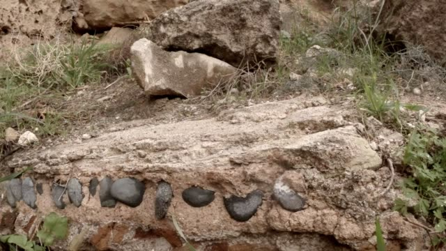 Different stones in layings of ruins antique town Salamis east Cyprus Famagusta video