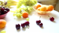 different Summer fruits on a table video