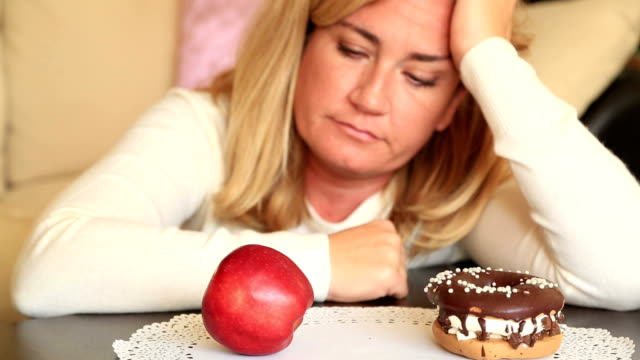 Difficult choice between healthy or junk food, diet concept video
