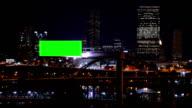 Digital advertising board in city at night video