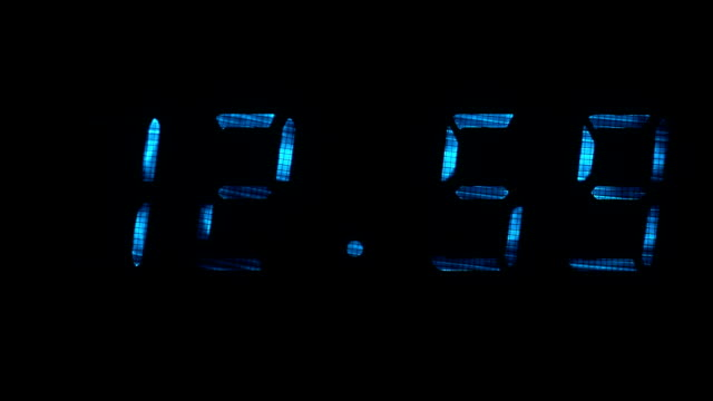 Digital clock shows the time of 12 hours 59 minutes to 13 hours 00 minutes video