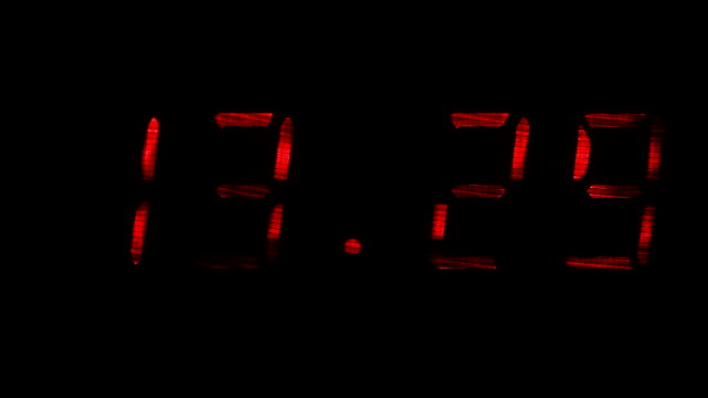 Digital clock shows the time of 13 hours 29 minutes to 13 hours 30 minutes video