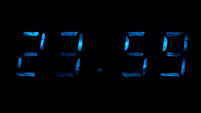 Digital clock shows the time of 23 hours 59 minutes to 00 hours 00 minutes video