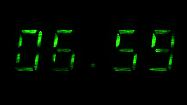 Digital clock shows time of 06 hours 59 minutes to 07 hours 00 minutes video