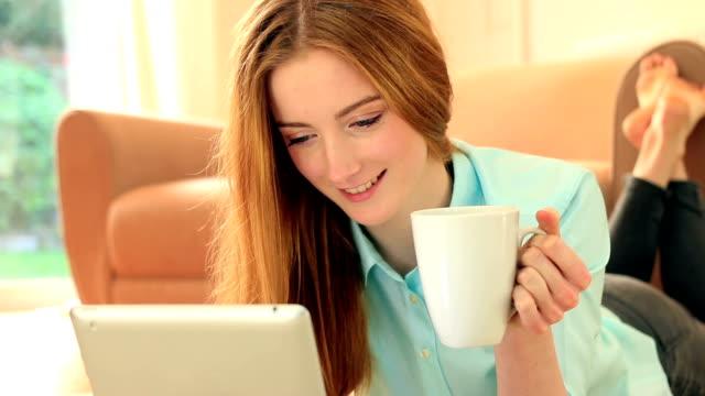 Digital tablet and coffee break. video