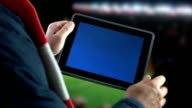 Digital tablet at the game. video