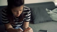 Digital tablet, young woman at home. video