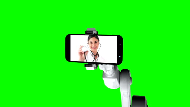 Digitally generated video of white robotic arm holding mobile phone that show medical icons on scree video