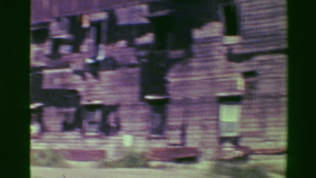 1976: Dilapidated tenement buildings falling apart ghetto 3rd world. video