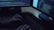 Diligent programmer writing a code at night video