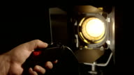 Dimming video studio Fresnel lens spot light on black background turn on/off video