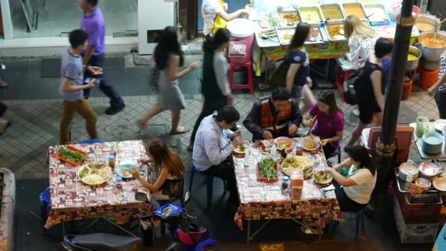 Dining on the sidewalk in Bangkok video