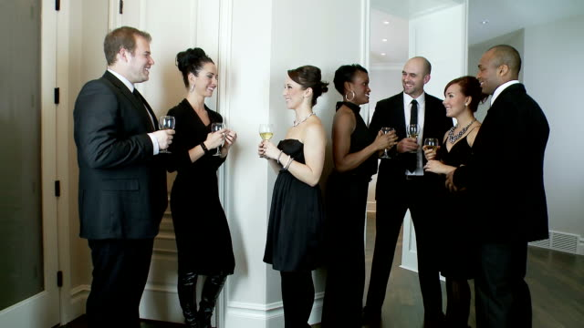 Dinner guests enjoy party video