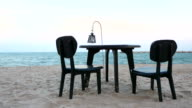 Dinner table set on the beach video