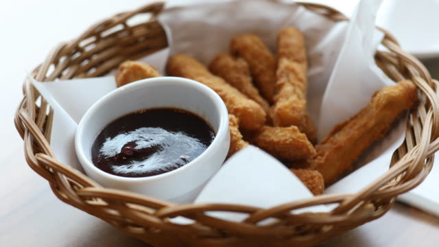 Dipping Chicken Stick into Sweet Chili Sauce, Closeup, low focus video