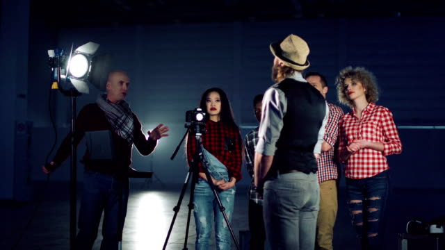 Director setting lighting on actor video