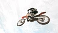 SLO MO Dirt biker jumping over dirt ramp video