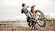 SLO MO Dirt biker riding fast through rutted turn video