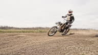Dirt biker riding through the turn video