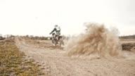 SLO MO Dirt biker speeding through the turn video