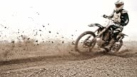 SLO MO Dirt bikers riding fast through the turn video