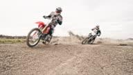 Dirt bikers riding fast through the turn video