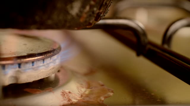 Dirty gas stove burners in kitchen room. video