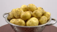 dirty potatoes in a colander before washing video