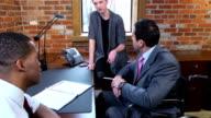 Disabled Businessman Discusses Report video