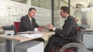 HD DOLLY: Disabled Businessman Having Meeting video